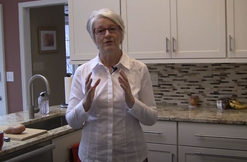 Cynthia Allen demonstrating 15 Exercises to Save Your Back Standing in the Kitchen