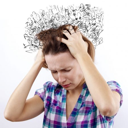 woman with headache holding her hand to the head. So many Thoughts